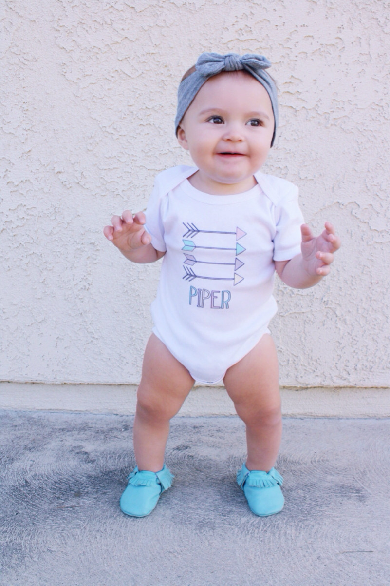 Piper modelling our Aztec Arrows Baby Name Onesie
