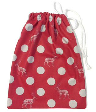 Red gift bag with dots and deers
