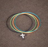 Multicolored bangle bracelet with cross dangle