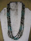 Long turquoise and Dalmation Jasper four strand necklace