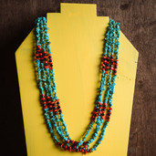 Banded two color chip four strand necklace
