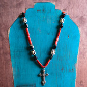 Cream, red and black long necklace with ornate cross pendant