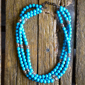 Blue and silver spacer three strand necklace