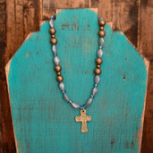 Slate blue oval bead necklace and hammered gold cross pendant
