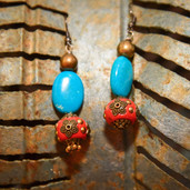 Detailed orange round bead, turquoise oval and wood bead earrings