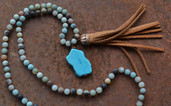 River rock Agate knotted bead necklace with saddle tan fringe tassel and TQ slab