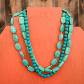 Triple strand assorted bead necklace