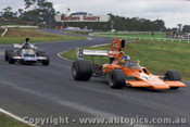 73633 - J. Walker Repco  Lola T300 & H. Sanquester McLaren M22 - Sandown 1973 - Photographer Peter D Abbs