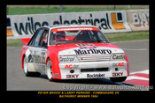 Peter Brock / larry Perkins -  Bathurst 1984 - 1st Outright Winner - Holden Commodore VK  - Photographer Lance J Ruting - Printed with a black border and a caption describing the photo.