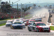 98701 - The Start - Bathurst 1998 - C. Lowndes  Commodore VT leads the field into the first corner.