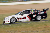 10704 - G. Tander / C. McConville  Holden Commodore VE   Bathurst 2010 - Photographer Craig Clifford