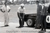 66085 - Norm Beechey Checking the tyre pressure of his Chev Nova - Warwick Farm 1966 - Photographer Lance J Ruting