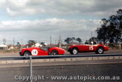 62424 - Allan Moffat Triumph TR3 / J. Colwell MGA  - Sandown  1962 - Photographer Laurie Johnson