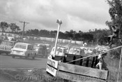 64745 - The first lap, heading up Mountain Straight - Bathurst 1964 - Photographer Lance Ruting