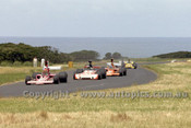 73651 -   Kevin Bartlett Lola T330 / J. Walker, Lola T330 Repco / John McCormack  Elfin / John Leffler Elfin MR5  - Gold Star Race Phillip Island 25th November 1973 - Photographer Peter D'Abbs