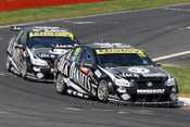 11712 - R. Kelly / O. Kelly & T. Kelly / David Russell -  Holden Commodore VE -  2011 Bathurst 1000  - Photographer Craig Clifford