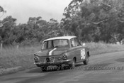 64766 - Ian & Leo Geoghegan - Ford Cortina GT - Check out the size of the camera on the back. -  Bathurst 1964 - Photographer Lance Ruting