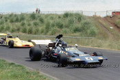 73656 -  Howie Sangster McLaren M22 & P. Feltham, Birrana 273 - Gold Star Race Phillip Island 25th November 1973 - Photographer Peter D'Abbs