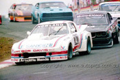 85062 - Graham Nowland, Mazda RX7 & Nick Middenway - Amaroo 7th July 1985 - Photographer Lance J Ruting