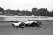 65550 - Phil Hill, Cooper - Sandown Tasman Series   21st February 1965  - Photographer Peter D'Abbs