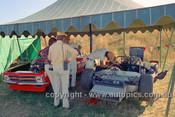 72466 - John Harvey, McLaren M6 next to the V8 Torana  - Phillip Island 1972 - Photographer Peter D'Abbs
