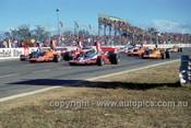 74657 - M. Stewart, Lola T330 / J. Walker, Lola T330 / K. Bartlett, Lola T332 /  J. Goss, Matich A53 / J. Davison, Matich A50 - Oran Park 4th August 1974 -  Photographer Jeff Nield