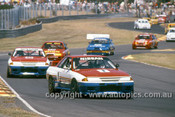 91026  -  Jim Richards & Mark Skaife, Nissan GT-R - Lead the field on the first lap -  Sandown - Photographer Darren House
