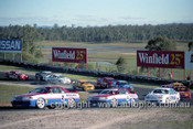 91027  -  Jim Richards & Mark Skaife, Nissan GT-R - Lead the field on the first lap -  Lakeside 14th July 1991 - Photographer Darren House