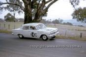 63714 - Keven Bartlett & Bill Reynolds, Holden EH S4 179 - Armstrong 500 Bathurst 1963 - Photographer Ian Thorn