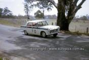 63715 - Bob Holden & Bill March, Peugeot 404 - Armstrong 500 Bathurst 1963 - Photographer Ian Thorn