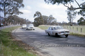 63718 - Geoff Russell & John Reaburn, Zephyr MKII - Jim Wright & Ian Ferguson, Studebaker Lark - Armstrong 500 Bathurst 1963 - Photographer Ian Thorn