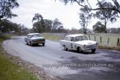 63719 - Ern Abbott & Alan Caelli, Ford Cortina 1500 & Morgan / Sach Holden EH S4 - Armstrong 500 Bathurst 1963 - Photographer Ian Thorn