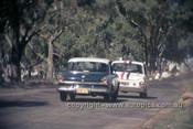 65772 - Warren Weldon & Bill Slattery, Studebaker Lark - Leo & Ian (Pete) Geoghegan Ford Cortina GT500 - Armstrong 500 Bathurst 1965 - Photographer Ian Thorn