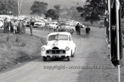 60014 -  Jim McKeown, Holden FX & Pete Geoghegan, Jaguar - Phillip Island 1960 - Photographer Peter DAbbs