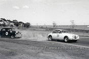 62111 - Bob Jane, Jaguar & Norm Beechey Holden FX - Calder 14th January 1962 - Photographer Peter D'Abbs