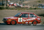 86056 - Mark Skaife, Ford Laser - Amaroo 1986 - Photographer Ray Simpson