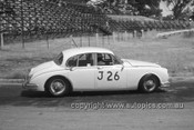 620029 -  Bob Jane, Jaguar 3.8 - Hume Weir 26th December 1962 - Photographer Bruce Wells.
