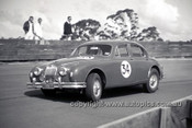 630013 -  Bill Burns, Jaguar - Catalina Park Katoomba  1963 - Photographer Bruce Wells.