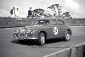 630013 -  Bill Burns, Jaguar - Catalina Park Katoomba  1963 - Photographer Bruce Wells.