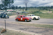 630048 - Bill Burns & Bob Jane, Jaguar  - Lakeside International 1963 - Photographer Bruce Wells.
