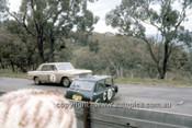 66755  - Warren Weldon & Bill Slattery, Studebaker Lark - Charlie Smith & Ron Haylen, Morris Cooper S  - Gallaher 500  Bathurst 1966 - Photographer Geoff Arthur