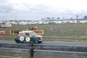 66758  - Rauno Aaltonen & Bob Holden, Morris Cooper S - A rare colour shot of the winning car - Gallaher 500  Bathurst 1966 - Photographer Geoff Arthur