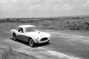 59418  - John Bissett, Buckle - Phillip Island 1959 - Photographer Peter D'Abbs