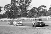 66089 - B. Thomas, Mustang - S. Martin, Lotus Cortina - R. Beasley, Austin Cooper S - Warwick Farm 1966 - PhotographerBruce Wells