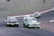 63032 - J. Maddock, Holden FX & B. Muir Valiant - Oran Park 1963 - Anne Blackwood Collection