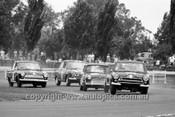 64080 - I. Geoghegan, Lotus Cortina - P. Manton & B. Foley, Morris Cooper S - J. McKeown, Lotus Cortina & B. Seton, Cortina - 1964 Warick Farm  - Photographer  Bruce Wells