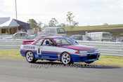 91029 - Jim Richards,  Nissan GTR  On two wheeles at Lakeside  1991 - Photographer Marshall Cass