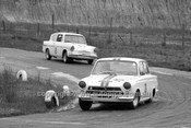 64127 - Bob Jane, Lotus Cortina & Brian Sampson, Ford Anglia  - Hume Weir 20th September 1964 - Photographer Bruce Wells