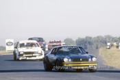 80079 - Kevin Bartlett, Camaro  & Bob Morris Commodore VC Surfers Paradise 1980