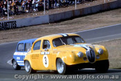 70076  -  B. Taylor Jaguar / L Manticas  Morris Mini - Oran Park 1970 - Photographer David Blanch